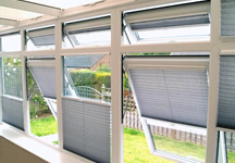 'Double float' conservatory blinds in steel blue