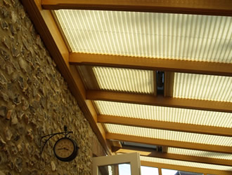 Conservatory roof blinds in cream