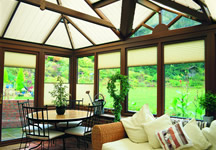 Motorised pleated conservatory blinds in cream