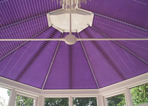 Purple conservatory roof blinds with 'pleat memory'