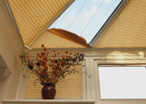 Obtused angled conservatory roof blinds in yellow