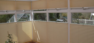 Split-draw conservatory window blinds in cream