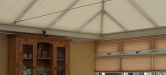 Cream conservatory window blinds and white roof blinds