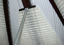 Conservatory roof blinds operated by pole